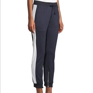 Jogger with side stripe and ankle zip detail